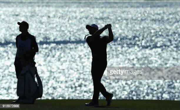 Paul Casey of England plays his second shot into the eighth hole during Round One of the ATT Pebble Beach ProAm at Pebble Beach Golf Links on...
