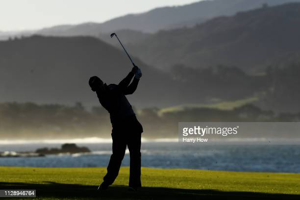 Paul Casey of England plays his second shot on the 18th hole during the continuation of the final round of the ATT Pebble Beach ProAm at Pebble Beach...