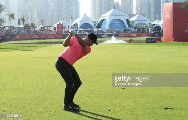 Paul Casey of England plays his second shot on the par five 18th hole during the third round of the Omega Dubai Desert Classic at Emirates Golf Club...