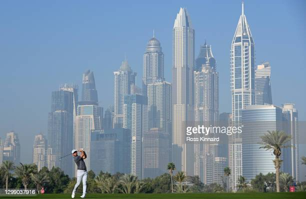 Paul Casey of England plays his second shot on the thirteenth during Day One of the Omega Dubai Desert Classic at Emirates Golf Club on January 28,...