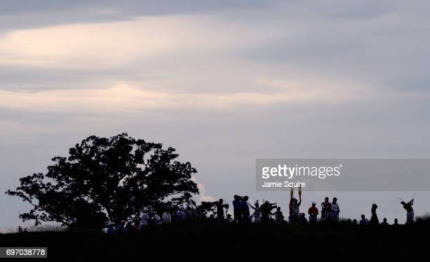 Paul Casey of England plays his shot from the 13th tee during the third round of the 2017 US Open at Erin Hills on June 17 2017 in Hartford Wisconsin