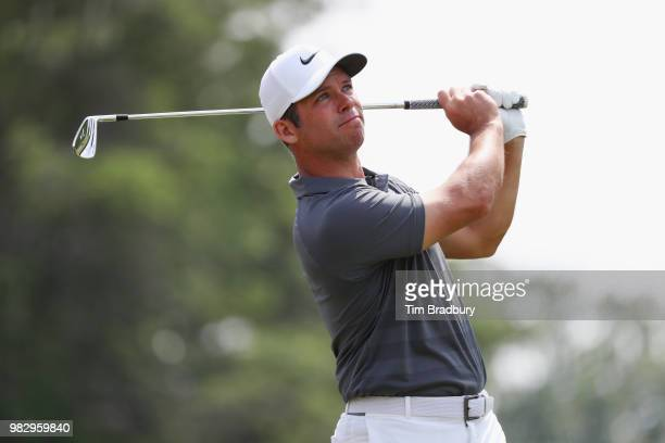 Paul Casey of England plays his shot from the fifth tee during the final round of the Travelers Championship at TPC River Highlands on June 24 2018...