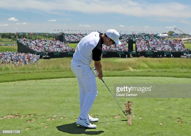 Paul Casey of England plays his tee shot on the par 3, ninth hole during the second round of the 117th US Open Championship at Erin Hills on June 16,...