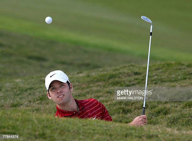 Paul Casey of England plays out of a bunker on the final day of the five million USD HSBC Champions golf tournament at the Sheshan International Golf...
