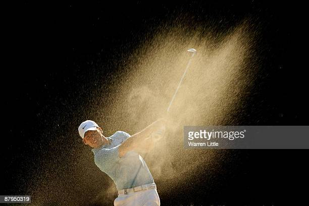 Paul Casey of England plays out of a fairway bunker on the 16th during the Final Round of the BMW PGA Championship at Wentworth on May 24 2009 in...