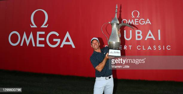 Paul Casey of England poses with the trophy after winning the Omega Dubai Desert Classic at Emirates Golf Club on January 31, 2021 in Dubai, United...