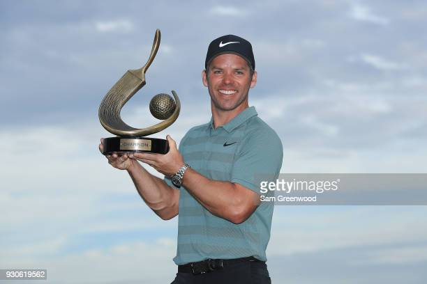 Paul Casey of England poses with the Valspar Championship trophy after winning at Innisbrook Resort Copperhead Course on March 11 2018 in Palm Harbor...