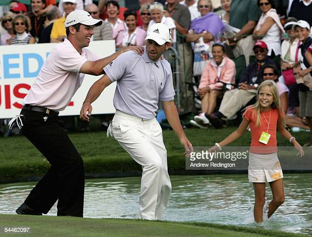 Paul Casey of England pretends to push Sergio Garcia of Spain into the lake by the 18th green as a young girl looks on during The Ryder Cup Challenge...