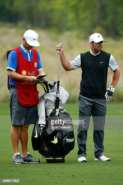 Paul Casey of England pulls a club from his bag on the sixth hole during the final round of the Shell Houston Open at the Golf Club of Houston on...