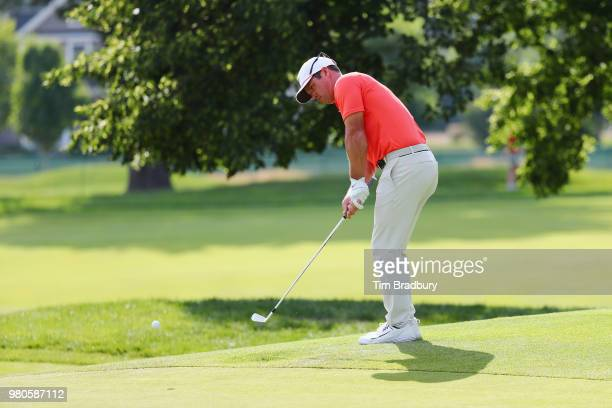Paul Casey of England putts on the fifth green during the first round of the Travelers Championship at TPC River Highlands on June 21 2018 in...