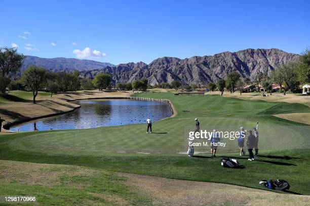Paul Casey of England putts on the fifth hole during the final round of The American Express tournament on the Stadium course at PGA West on January...