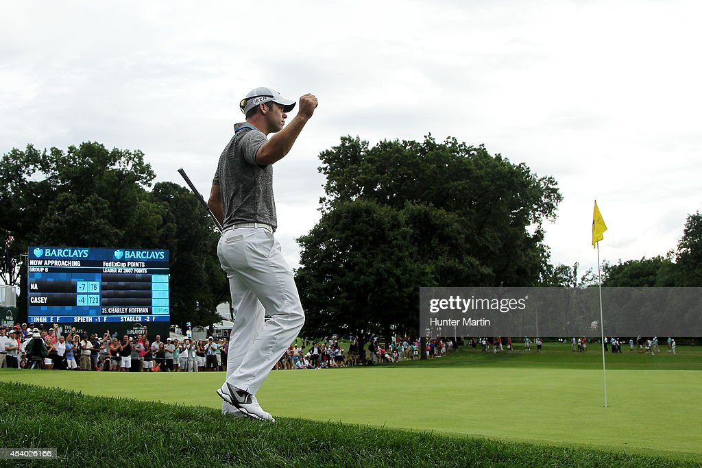 Paul Casey of England reacts after chipping in for birdie on the 18th green during the third round of The Barclays at The Ridgewood Country Club on August 23, 2014 in Paramus, New Jersey.