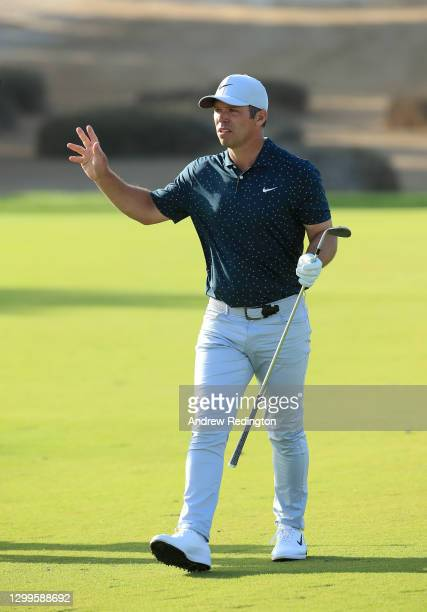 Paul Casey of England reacts after playing his second shot on the 17th hole the during the final round of the Omega Dubai Desert Classic at Emirates...