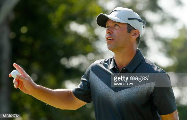 Paul Casey of England reacts to his eagle on the sixth green during the third round of the TOUR Championship at East Lake Golf Club on September 23...
