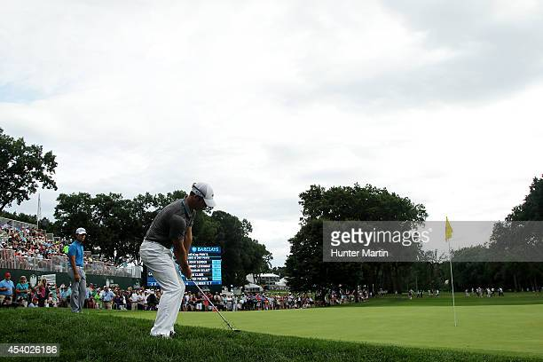 Paul Casey of England ships in for birdie on the 18th green during the third round of The Barclays at The Ridgewood Country Club on August 23 2014 in...