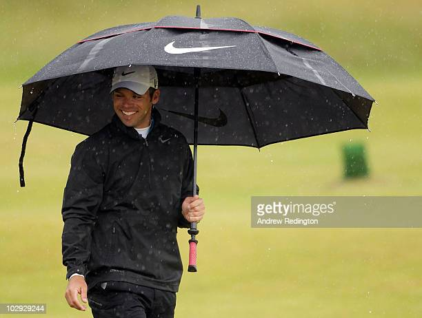 Paul Casey of England walks under an umbrella up the fifth hole during the second round of the 139th Open Championship on the Old Course St Andrews...