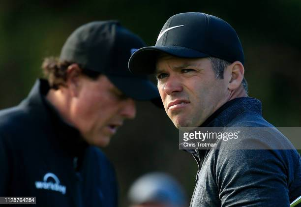 Paul Casey of England watches his shot from the fourth tee as Phil Mickelson of the United States prepares to play during the final round of the ATT...