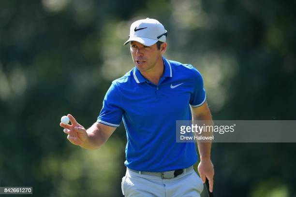 Paul Casey of England waves after putting for birdie on the fifth green during the final round of the Dell Technologies Championship at TPC Boston on...
