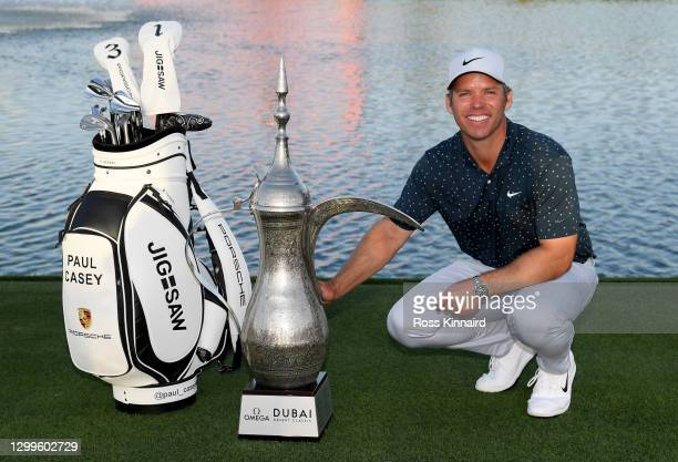 Paul Casey of England with the winners trophy on the 18th green after the final round of the Omega Dubai Desert Classic at Emirates Golf Club on...