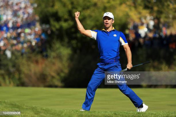 Paul Casey of Europe celebrates a putt on the second green during singles matches of the 2018 Ryder Cup at Le Golf National on September 30 2018 in...