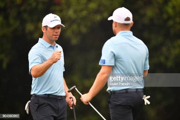 Paul Casey of Europe celebrates with Tyrrell Hatton during the foursomes matches on day two of the 2018 EurAsia Cup presented by DRBHICOM at...