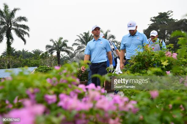 Paul Casey of Europe walks with Tyrrell Hatton during the foursomes matches on day two of the 2018 EurAsia Cup presented by DRBHICOM at Glenmarie GCC...