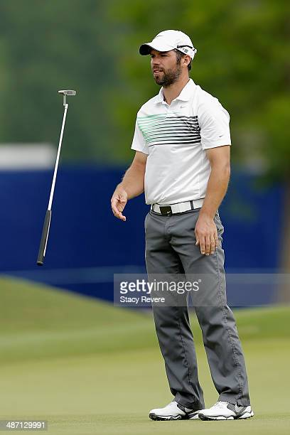 Paul Casey tosses his club on the 14th during the Final Round of the Zurich Classic of New Orleans at TPC Louisiana on April 27, 2014 in Avondale,...