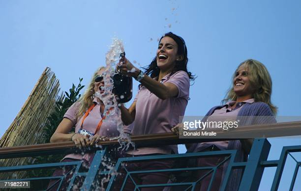 Paul Casey's girlfriend Jocelyn Hefner Luke Donald's fiancee Diane Antonopoulos and Morgan Norman celebrate on the clubhouse balcony with champagne...