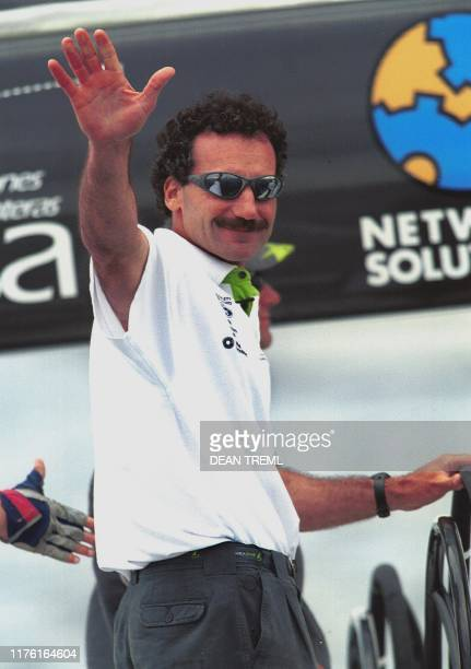 "Paul Cayard, skipper of the Saint Francis Yacht Club's ""America One"" gives a happy wave 08 January 2000, after beating rivals ""Stars & Stripes"" today..."
