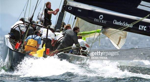 Paul Cayard, , skipper of the St. Francis Yacht Club's AmericaOne, looks right to check on the position of Prada Challenge's Luna Rossa while...