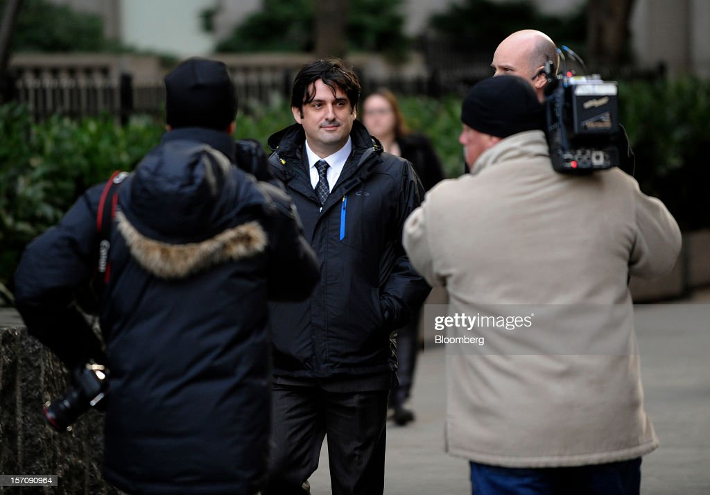 Paul Ceglia, indicted on charges of mail fraud and wire fraud, center, exits federal court in New York, U.S., on Wednesday, Nov. 28, 2012. Ceglia, 39, pleaded not guilty to criminal charges that he faked evidence in his contract lawsuit against Facebook Inc. and its chief executive officer, Mark Zuckerberg. Photographer: Peter Foley/Bloomberg via Getty Images