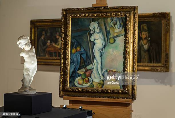 Paul Cezanne's artwork 'Still Life with Plaster Cast' is displayed at the Courtauld Gallery on March 18 2015 in London England The cupid statue is...