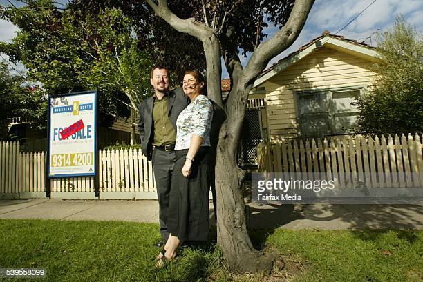 Paul Chandley and Judy Hertz with the house they signed up to buy in Yarraville. Interest rates went up by .25 basis points on the same day meaning...