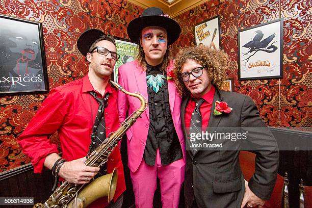 Paul Cheenne Win Butler and Ben Jaffe pose for a photo at One Eyed Jacks following a second line honoring David Bowie on January 16 2016 in New...