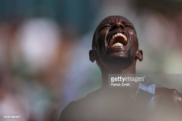 Paul Chelimo reacts after winning Men's 5,000 Meter Run during day ten of the 2020 U.S. Olympic Track & Field Team Trials at Hayward Field on June...