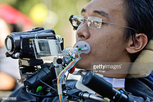 Paul Chiou who is quadriplegic video tapes Spinal Injury Games played at Rancho Los Amigos National Rehabilitation Center on Friday morning in Downey...