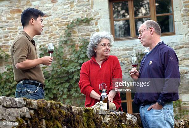 Paul Chiu left Becky Wasserman center and Robert Lyster taste wine at the Bouilland wine seminar in the Bourgogne region France August 30 2006 The...