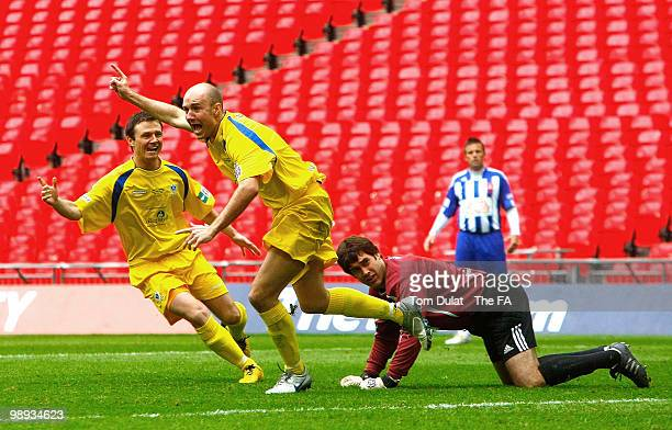 Paul Chow of Whitley Bay celebrates after scoring the opening goal of the FA Carlsberg Vase Final match between Whitley Bay and Wroxham at Wembley...