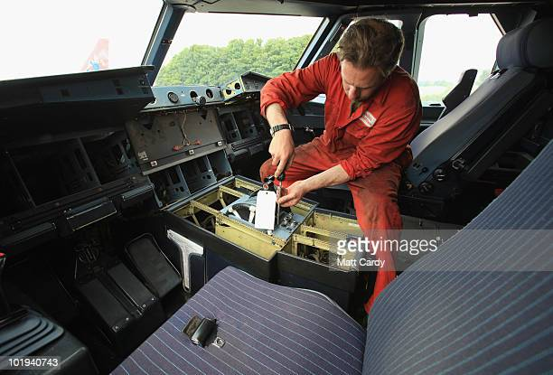 Paul Clay, an employee of Air Salvage International, works in the flight deck on June 9, 2010 in Kemble, England. The aircraft is one of a number...