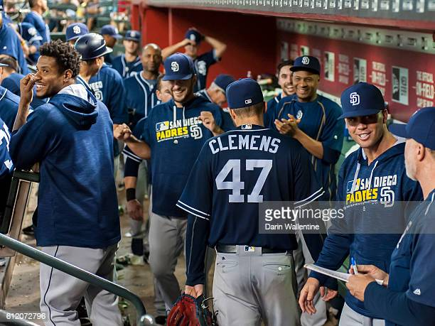 Paul Clemens of the San Diego Padres is congratulated by his teammates after the seventh inning during the MLB game against the Arizona Diamondbacks...