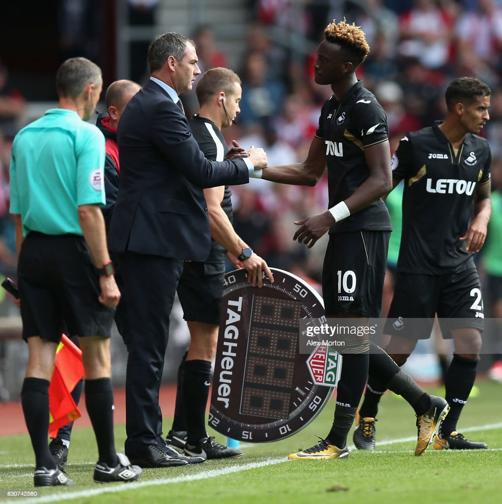 Paul Clement, Managaer of Swansea City and Tammy Abraam of Swansea City embracec during the Premier League match between Southampton and Swansea City at St Mary's Stadium on August 12, 2017 in Southampton, England.