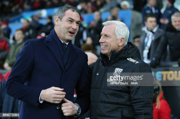 Paul Clement manager / head coach of Swansea City and Alan Pardew the head coach / manager of West Bromwich Albion before the Premier League match...