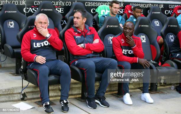 Paul Clement manager / head coach of Swansea City sits on the bench with assistant coaches Nigel Gibbs and Claude Makelele during the Carabao Cup...