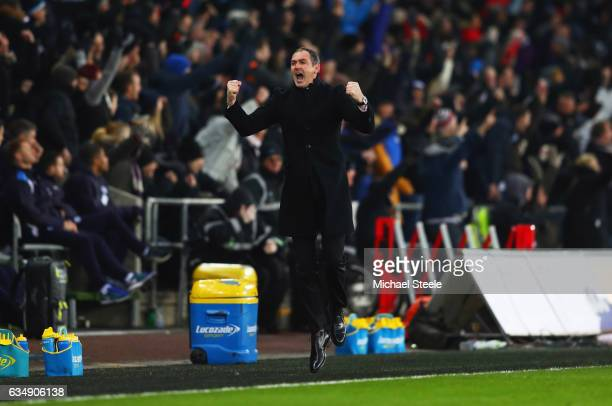 Paul Clement manager of Swansea City celebrates as Martin Olsson of Swansea City scores their second goal during the Premier League match between...