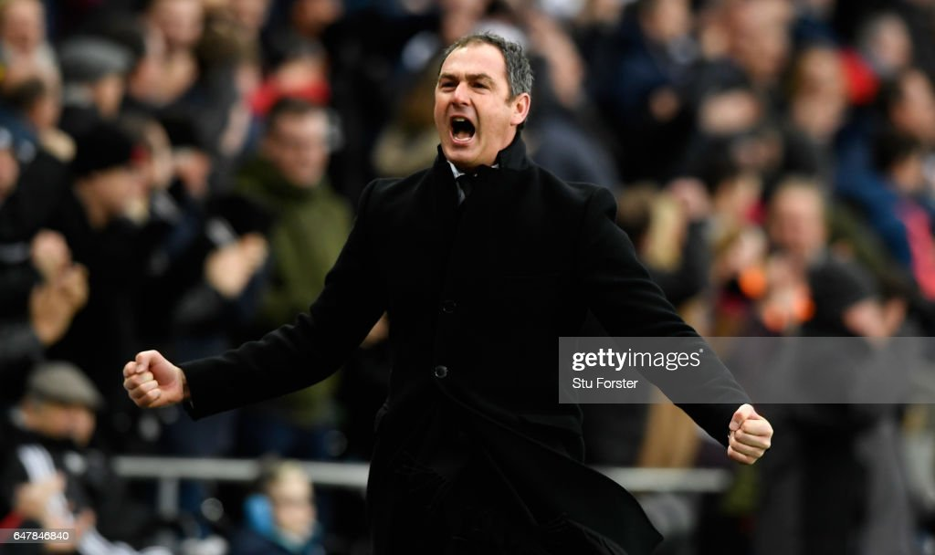 Paul Clement, Manager of Swansea City celebrates his sides third goal during the Premier League match between Swansea City and Burnley at Liberty Stadium on March 4, 2017 in Swansea, Wales.