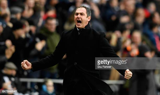 Paul Clement Manager of Swansea City celebrates his sides third goal during the Premier League match between Swansea City and Burnley at Liberty...