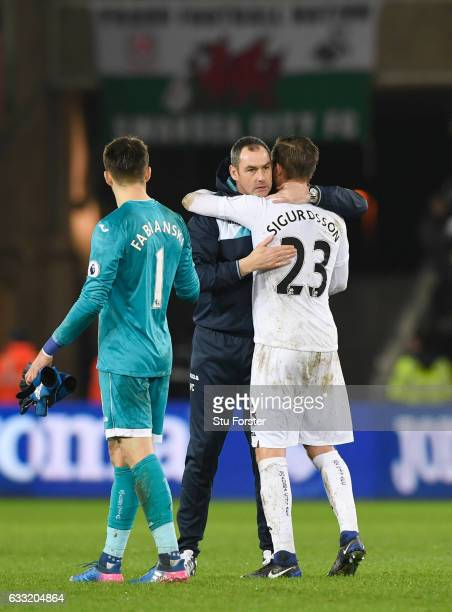Paul Clement Manager of Swansea City congratulates Gylfi Sigurdsson during the Premier League match between Swansea City and Southampton at Liberty...