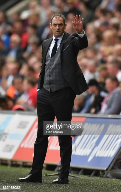 Paul Clement Manager of Swansea City gives his team instructions during the Premier League match between Swansea City and Manchester United at...