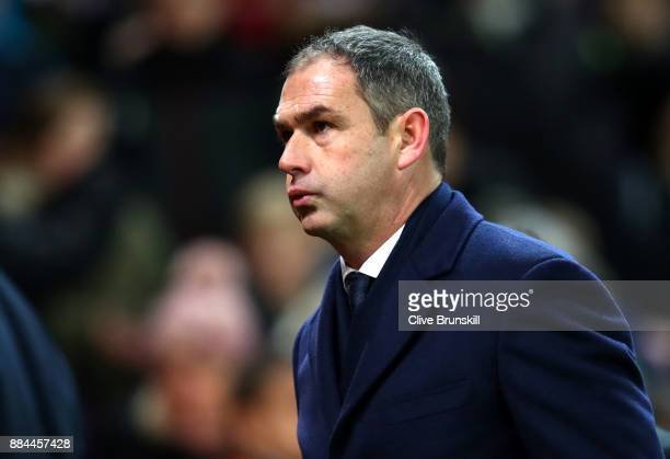 Paul Clement Manager of Swansea City look dejected after the Premier League match between Stoke City and Swansea City at Bet365 Stadium on December 2...
