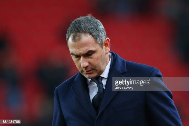 Paul Clement Manager of Swansea City look dejected during the Premier League match between Stoke City and Swansea City at Bet365 Stadium on December...